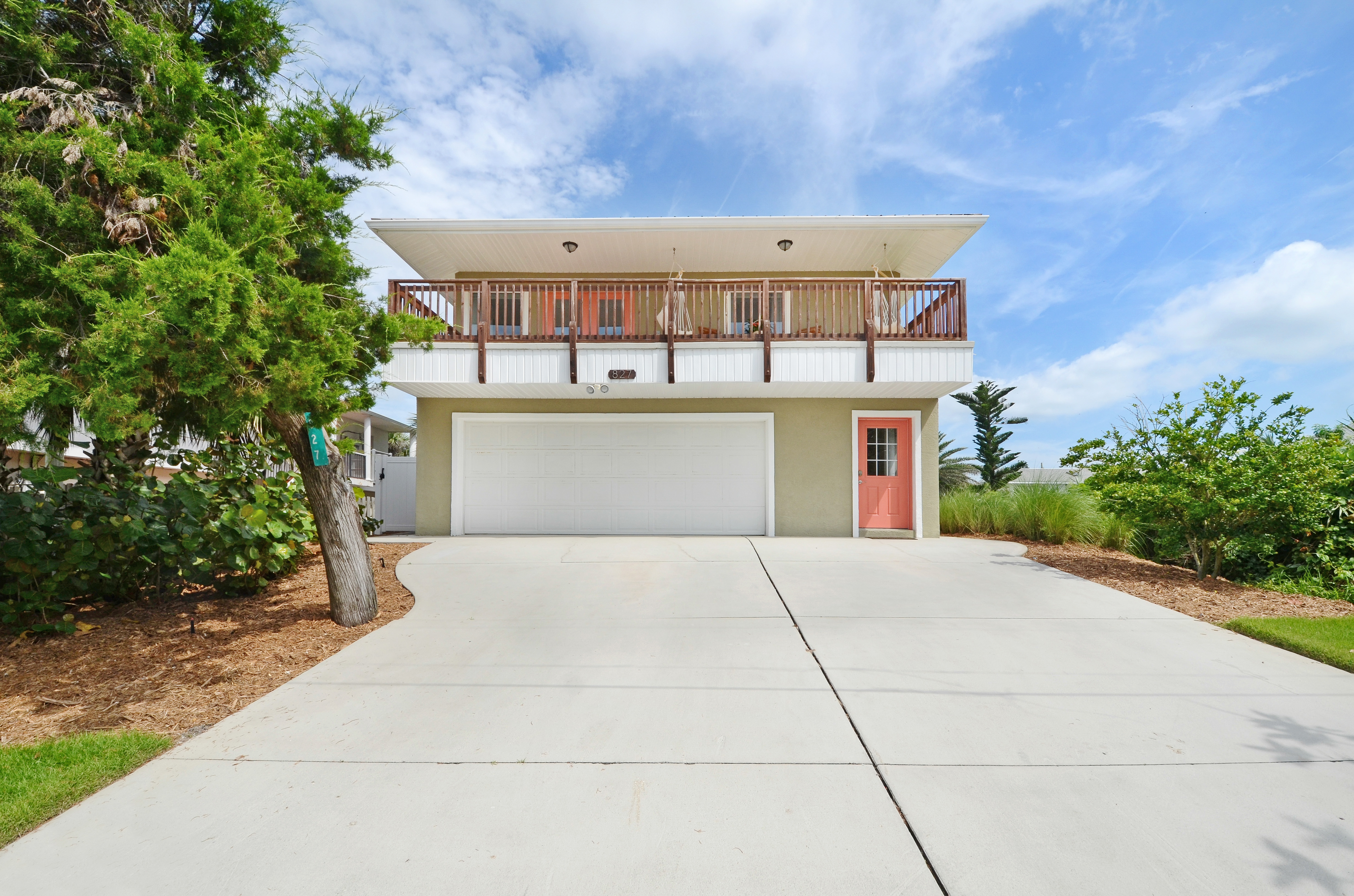 New Smyrna Beach pool home steps from the beach and river